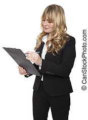 Businesswoman writing notes on a clipboard - Beautiful young...