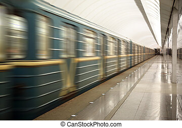 train moving at subway station