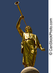 Moroni - The golden statue of the angel Moroni on top of the...