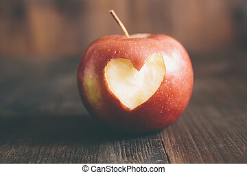 Apple with a heart cut into it - Valentine Day concept,...