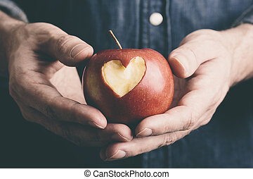 hands with apple - Valentine Day concept, selective focus on...