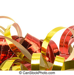 carnival - closeup of golden and red paper streamers