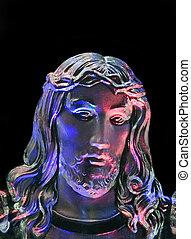 Jesus in Highlights - A closeup of a crystal sculpture of...