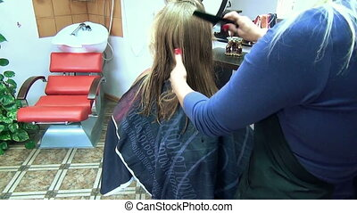 barber cut hair zoom - Zoom in of hairdresser woman hands...