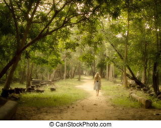 Woman Walking on Mysterious Path - Young woman walking...