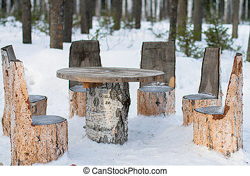 Table and chairs made of tree trunks