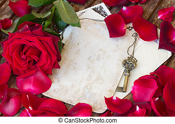 vintage background with rose petals  and key