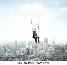 man sitting on a swing - businessman sitting on a swing -...