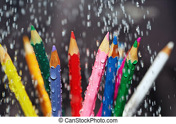 Color pencils under the rain. Close-up view