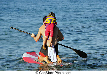 Father and Daughter Paddle Boarding - A Father and Daughter...