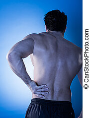 Man Suffering From Back Pain - Rear View Of Young Man...