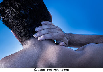 Man Suffering From Neck Pain - Rear View Of Young Man...