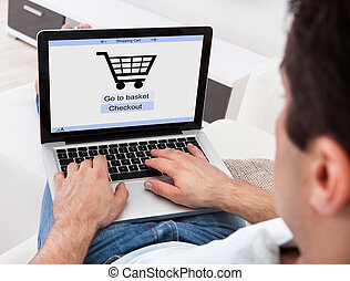 Man Shopping Online - Businessman Using Laptop With Online...