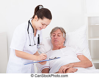Doctor Giving Prescriptions - Senior Male Patient Looking At...