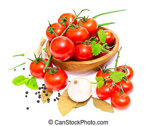 The branch of cherry tomatoes in a wooden bowl, onion,...
