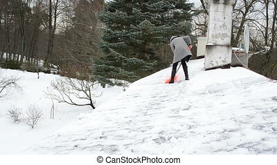 woman clean snow roof