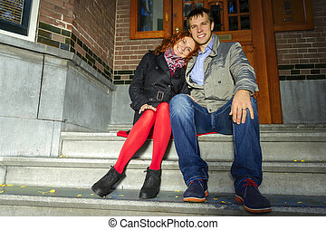 Outdoor happy couple in love,autumn Amsterdam background