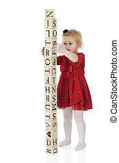 Steady Now! - An adorable, dressed up preschool girl...