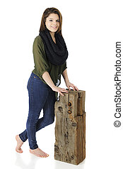 Beautiful Teen by an Old Beam - A beautiful barefoot teen...