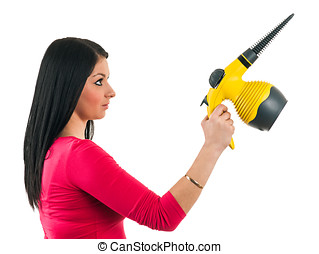 Young housewife prepares a steam cleaner to clean
