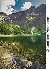 Mountain lake in summer on the background of rocky mountains