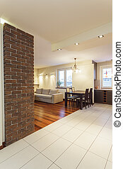 Spacious apartment - living room with brick wall