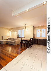 Spacious apartment - table in living room - Spacious...