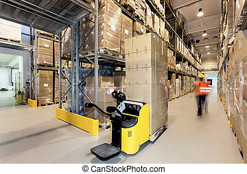 Forklift in warehouse - Forklift with products in a...