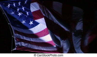 American Flag at Night - Close-up of large american flag...