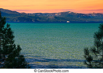 Lake Tahoe - Lake with mountain range in the background,...