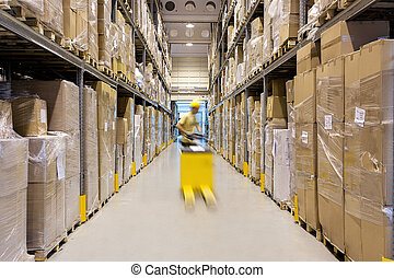 Worker in a warehouse - Warehouse worker with a yellow hand...