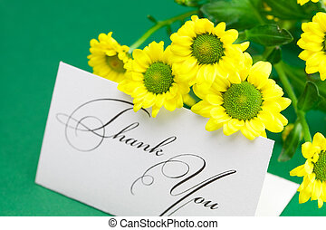 yellow daisy and card signed thank you on green background