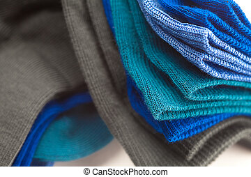 background of multi colored socks made of cotton