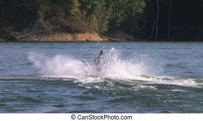 Jet Ski Jumps - Jet ski jumps on lake.