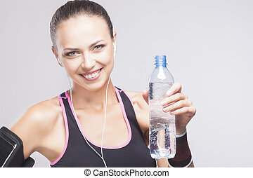 Portrait of Fit Woman with Bottle of Pure Water - Portrait...