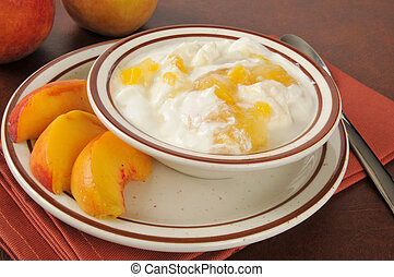 Greek yogurt with fresh peaches - A bowl of healthy Greek...