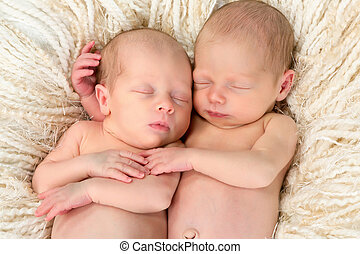Twin babies together - Ten days old newborn twin babies...
