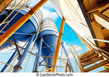 cement factory - Concrete mixing tower. Concept of on-site...