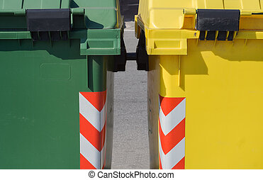 Two colorful rubbish bin detail - Close up of two half...