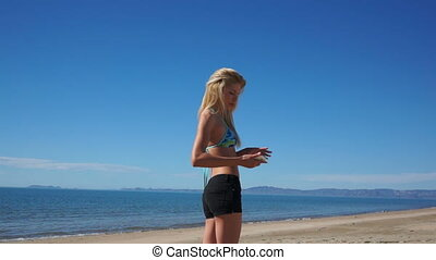Girl Beach Shorts Selfie - Girl on a beach in shorts and...