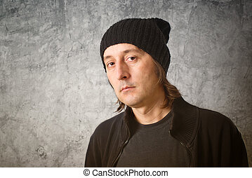 Portrait of Casual Man with Black Cap