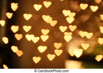 Heart bokeh on a dark background.