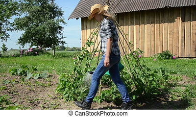 gardener woman water bean - Gardener girl woman with hat...