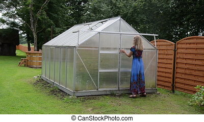 woman greenhouse door