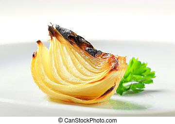 Pan roasted onion wedge on plate