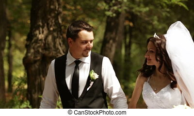 Groom and bride stopped and spin - Fiancee and groom go for...