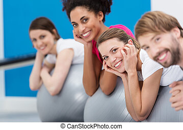 Smiling group of friends practicing Pilates