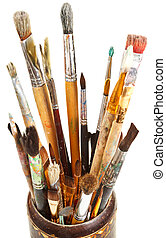 many used artistic paintbrushes in wooden cup isolated on...