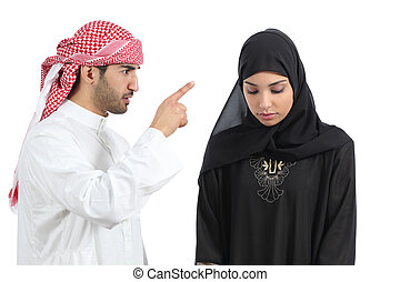 Arab couple with a man arguing to his wife isolated on a...