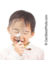 asian boy holding magnifier and close eyes